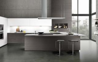 Cucina moderna_Touch.03_composizione con penisola angolare nelle finiture rovere tinto grigio scuro, laccato opaco bianco e top in sintetico bianco. Maniglia a filo anta con presa push nella finitura dell'anta