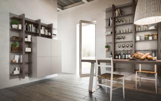 Cucina moderna_Lounge.01_dettaglio due librerie sospese che arredano la zona pranzo. Elementi pensili libreria con montante verticale centrale a forte spessore e mensole in metallo laccato opaco