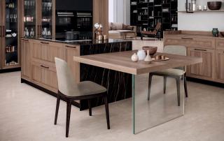 Cucina contemporanea_Marilyn 45.02_dettaglio tavolo con top a forte spessore in legno. Sembra sospeso nel vuoto, una lastra in vetro temperato lo sostiene, conferendo una sensazione di leggerezza alla parte terminale dell'isola